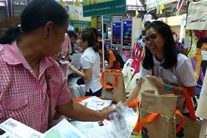 Volunteers hand out TB information in Asia