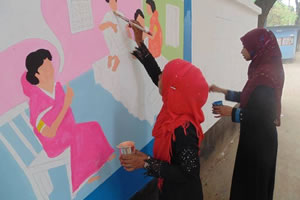 Children in Bangladesh paint a mural for World TB Day