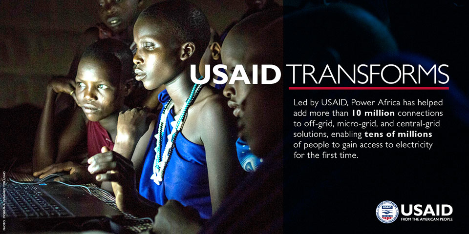 Photo of a group of women at a computer screen. Text states: USAID Transforms. Led by USAID, Power Africa has helped add more than 10 million connections to off-grid, micro-grid and central-grid solutions, enabling tens of millions of people to gain access to electricity for the first time.