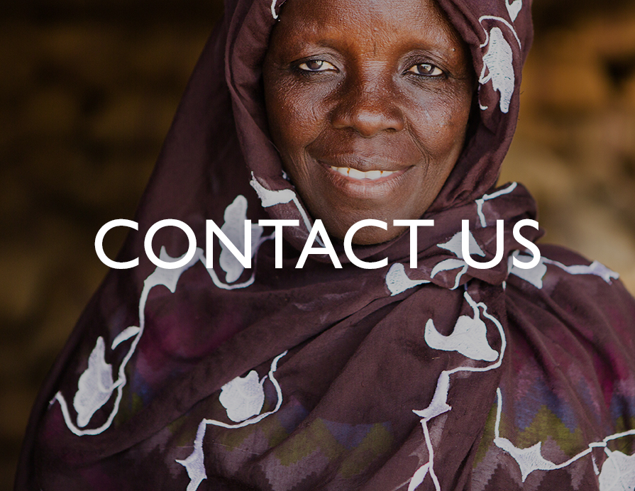 Contact Us - A close-up photo of a smiling woman