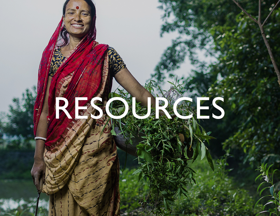 Resources - A smiling woman standing outdoors