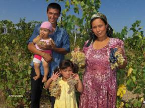 A family shows their best grape harvest in Namangan Province.