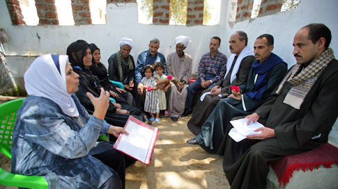 Men and women in Egypt engaging in dialogue
