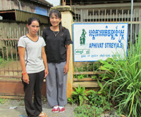 Vann Sara, left, and Thong Thavrin of the NGO Aphivat Strey, which designed a project proposal based on Feed the Future's Cambod