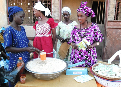 USAID Community Nutrition Volunteer Raky Mamadou Niane (right), Ramata Bocoum (left) and the women of Jab Gollade.