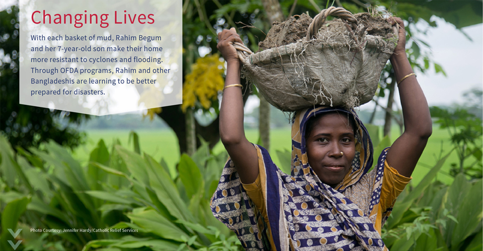 With each basket of mud, Rahim Begum and her 7-year old son make their home more resistant to cyclones and flooding.