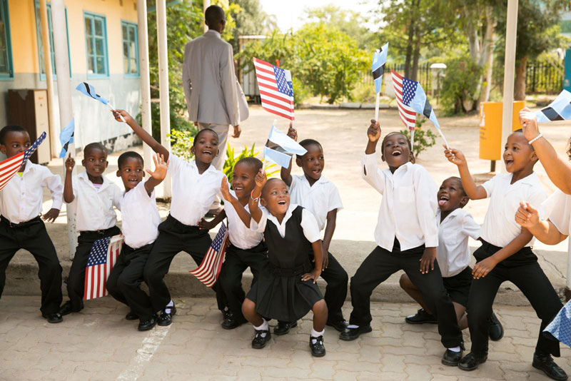 School children wave flags for World AIDS Day.