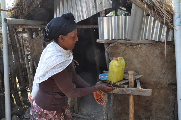 A woman practices safe hand washing in Ethiopia.