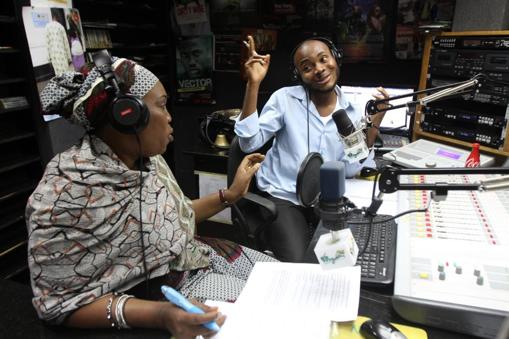 Radio anchor Oche discusses issues with a family planning expert, Mariam Momoh, during a live program about family planning on Wazobia FM in Abuja, Nigeria