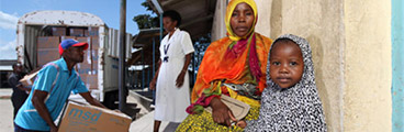 Mother Nasra Ally and child are waiting outside a clinic in the Northern Zonal Area of Tanzania's Dar es Salam