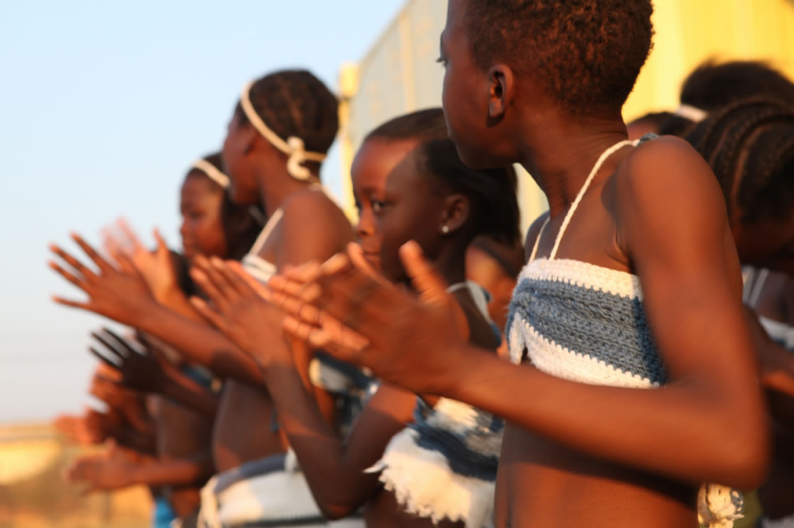 A group of young women dancing. Photo credit: Tash McCarroll/USAID