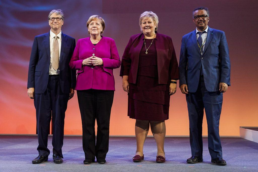 Photograph of Bill Gates, Angela Merkel, Dr. Ghebreyesus, and more at the Grand Challenges Meeting.