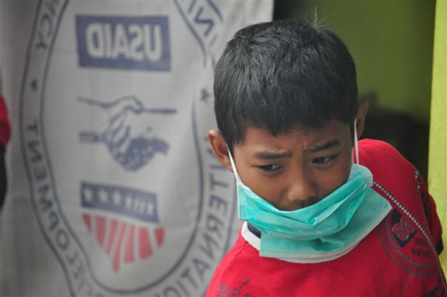 After evacuating his home due to an eruption of the Mt. Merapi volcano in Central Java Province in October 2010, this boy and hi