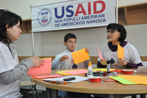 Albanian speaking students and their teacher during bookmaking activity