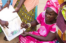A woman looks at malaria-related learning materials