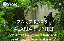 Zanzibar's Malaria Hunter - a woman rides a scooter