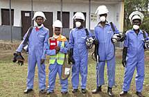 People wearing protective suits, breathing masks and helmets