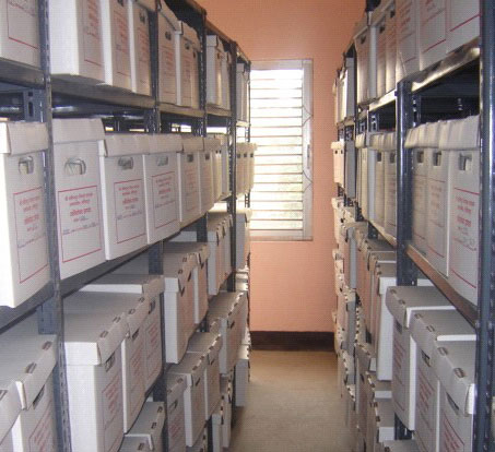 Lalitpur District Court file room with neatly organized and labeled file boxes