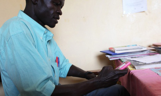 Teacher in South Sudan using SMS to register attendance to government website.