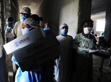 Personnel distribute USAID hygiene kits at a Cholera Treatment Center in Verrettes in the Artibonite department of Haiti.