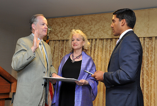 Administrator Rajiv Shah (right) swears in new Haiti Mission Director John Groarke. He was one of four new mission directors swo