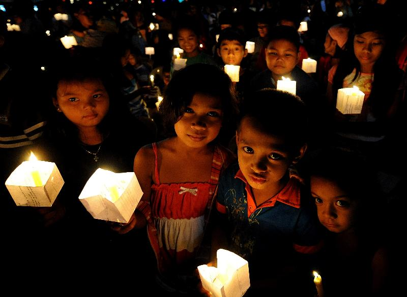 Children hold lighted candles during a prayer for Justice and Protection against Sex Trafficking of Children and Young People.