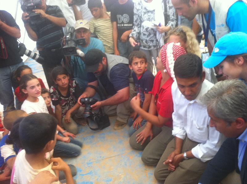 Administrator Shah speaks to Syrian refugee children during his visit to the Za'atri refugee camp in Jordan.