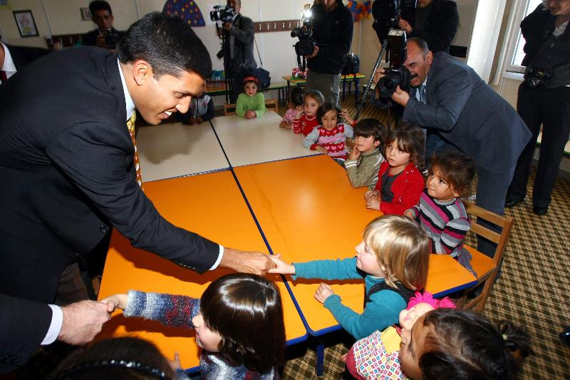 USAID's Raj Shah greets young Syrian children in Turkey. Photo Credit: Adem Altan / AFP
