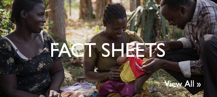 Fact Sheets: A family smiling at an infant