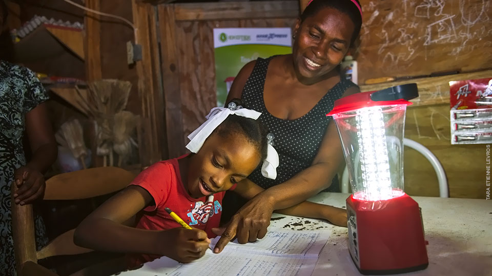 Phaima, Nancy Goldman's daughter, can now study in the evening thanks to a solar powered lamp.
