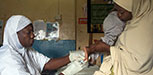 A nurse is taking a blood sample for dry blood test for HIV from a child in Minna, Niger state