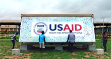 Photo of workers opening a USAID medical pod