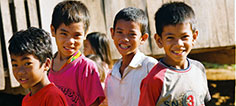 Children outside of the health center in Kampong Thom province in Cambodia, where oral re-hydration therapy is provided to children who have diarrhea. / PATH/Heng Chivoan