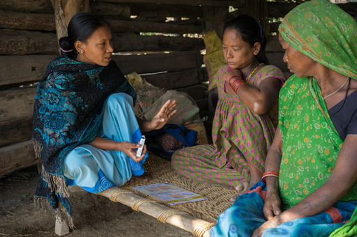 A woman provides instruction on the use of antiseptic gel in Nepal