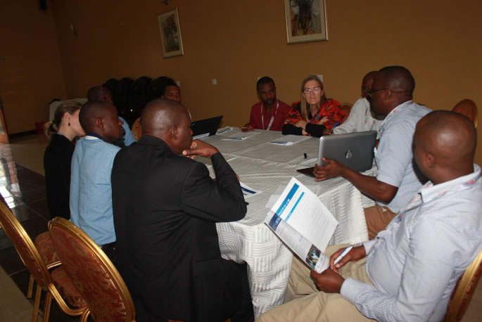 Share Fair attendees discuss the value of developmental evaluation. Photo credit: Coordinating Implementation Research to Communicate Learning and Evidence.