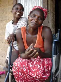 Photo of a woman in a wheel chair with a young boy