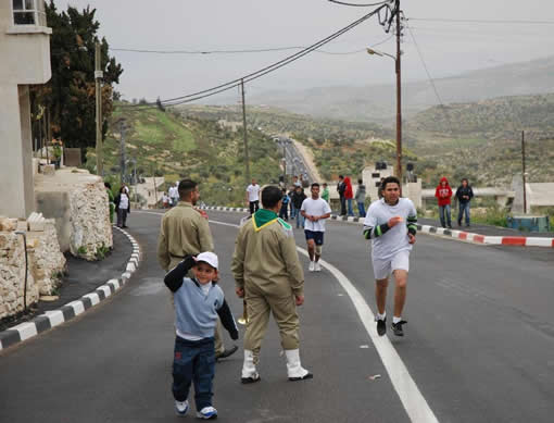 This West Bank road built by USAID is smooth and safe for drivers and pedestrians and even for a running race.