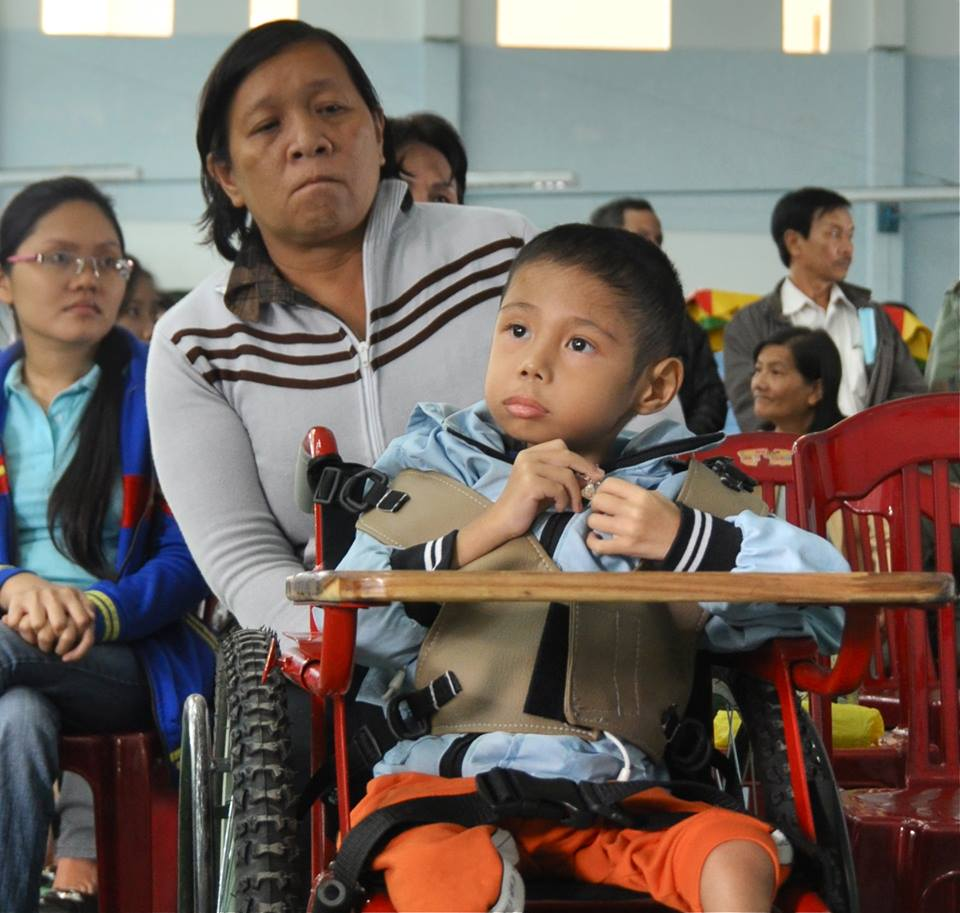 Nine-year-old Duong Binh An in Danang receives a specially-designed wheelchair from one of USAID disability projects.