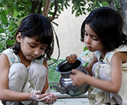 Women as Behavior Change Agents for Gaining Equity. Photo of two young girls playing.