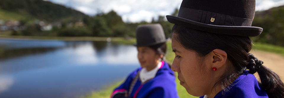 Colombian girls standing next to a lake. Credit: ACDI VOCA / David Osorio