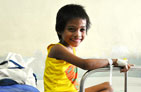 Photo of a smiling young TB patient in the hospital