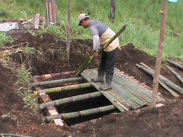 A worker constructs an infiltration pond in Mojokerto District.