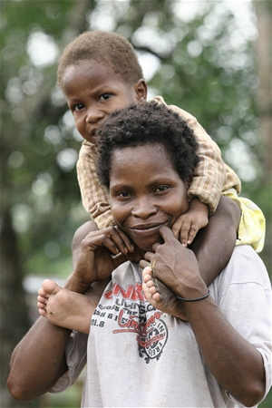A woman carries her healthy child.