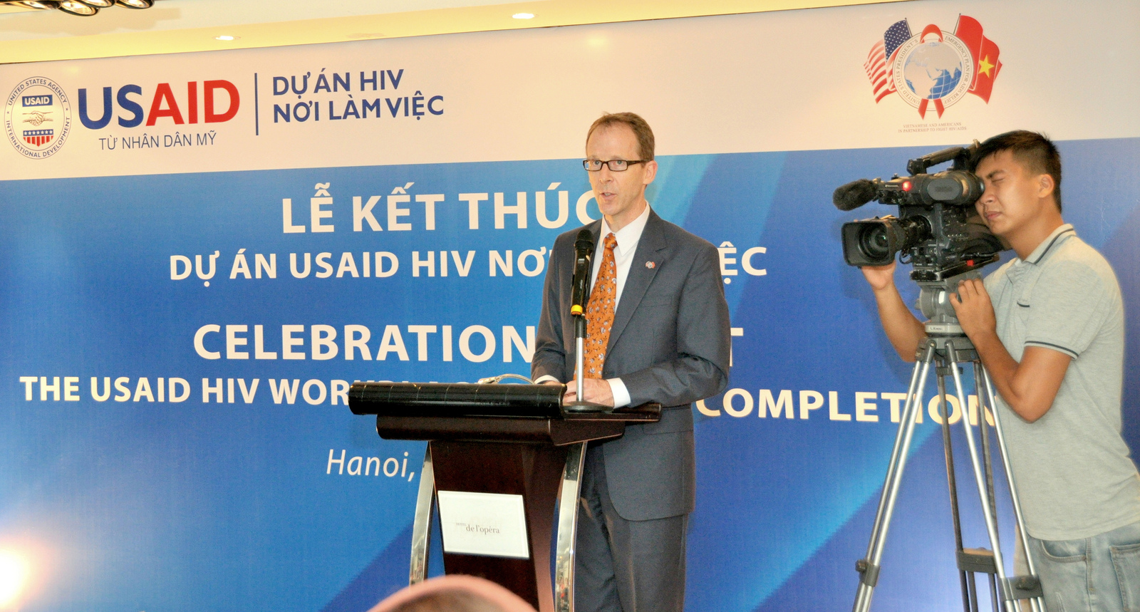 USAID Mission Director Joakim Parker addresses an event for the USAID HIV Workplace Project.