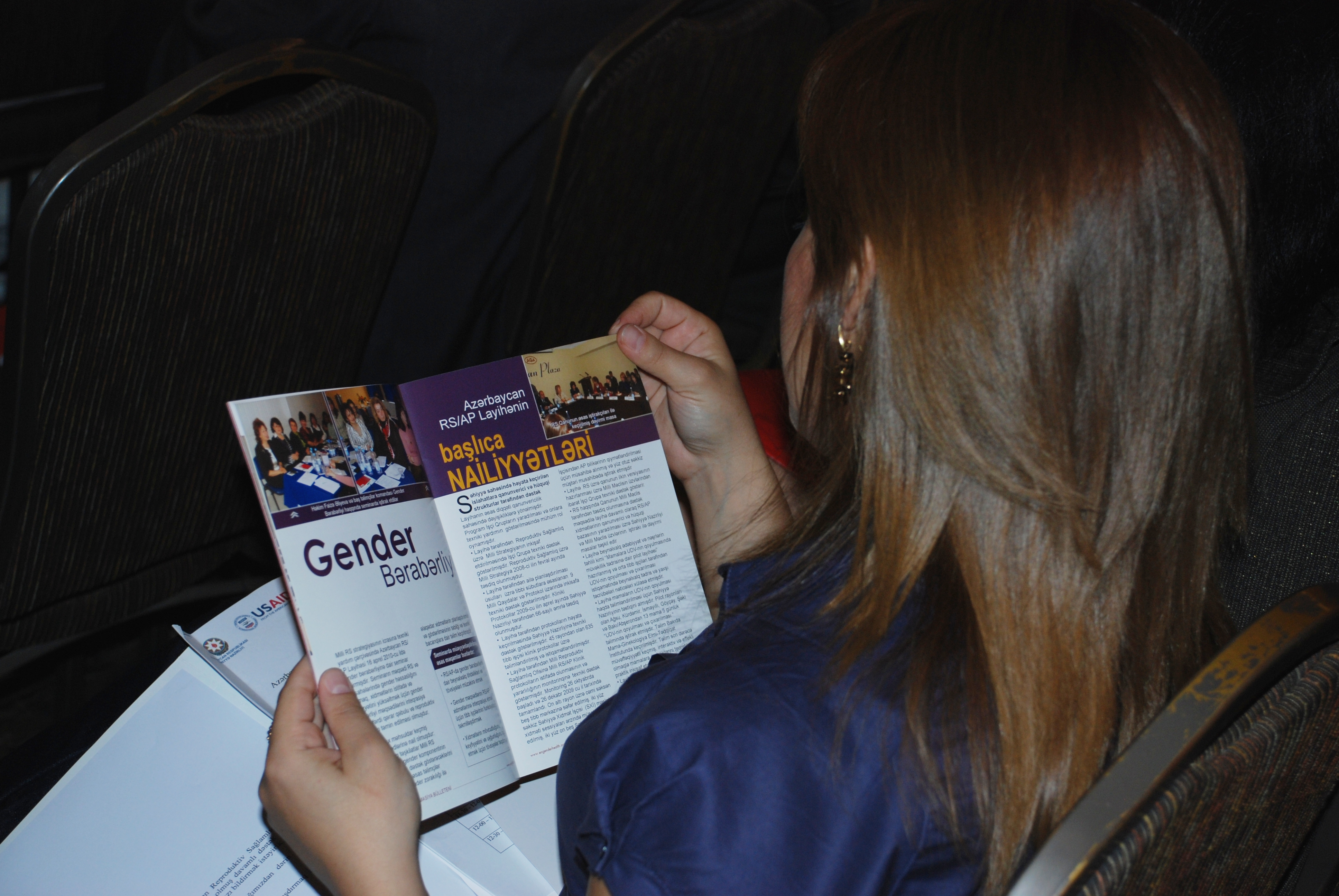 A woman browses program material