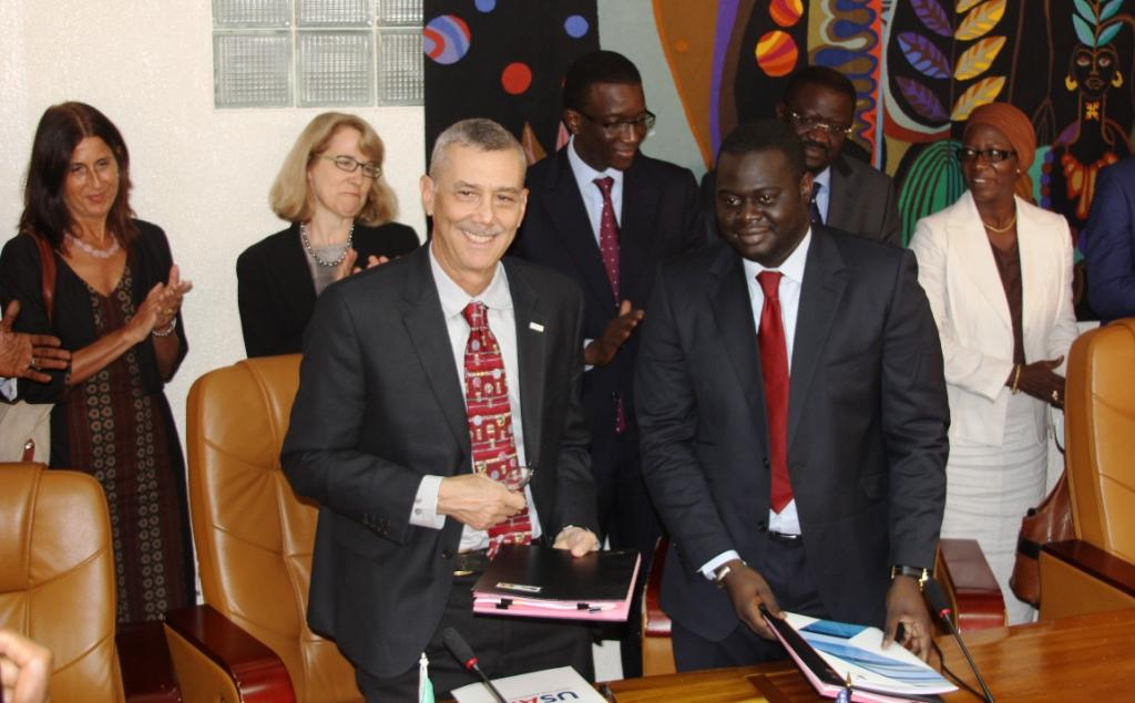USAID Deputy Assistant Administrator Richard Greene (front left) shakes hands with Khadim Ba (front right), Director General of