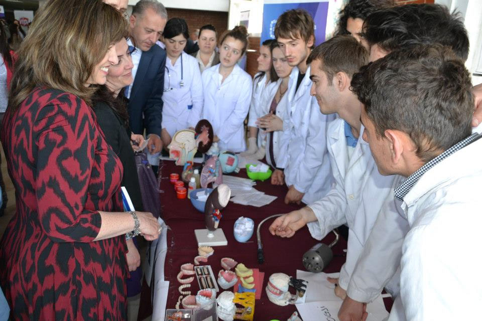 USAID Director Maureen A. Shauket with students of dental school in Mitrovicë on the Global Youth Service Day celebration