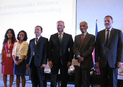 USAID, WaterLinks and private sector representatives sign agreement for more accessible water.
