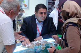 A buyer examines the Afghan almonds at the exhibition