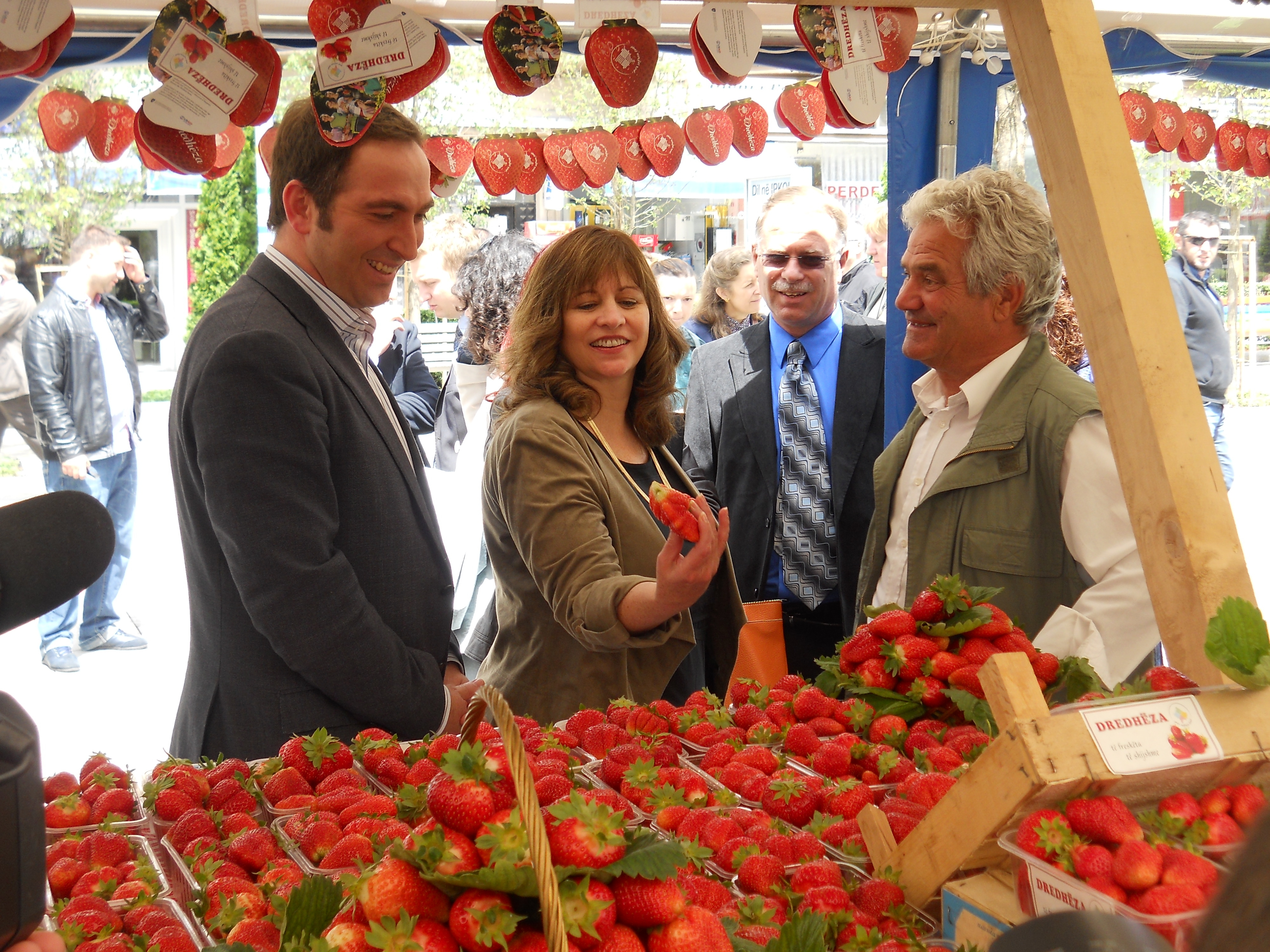 USAID Director and Minister of Agriculture tour the strawberry booths and talk to farmers